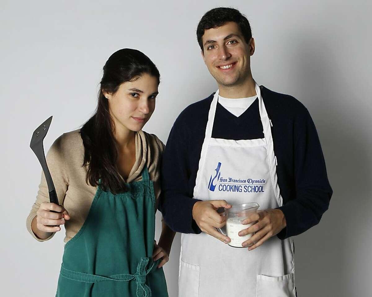 Sophie Brickman teaches her boyfriend Dave Eisenberg how to cook in San Francisco, Calif., on Saturday, Jan. 8, 2011.