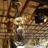 A l& made from an industrial size whisk hangs in Omega Too a unique lighting & Antiques repurposed as lighting - SFGate azcodes.com
