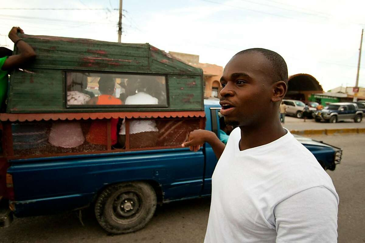 Wilberle Vereus walks around the Delmas neighborhood of Port-au-Prince in search of a hotel where his brother, Fritzner, can stay while visiting him from Los Angeles. CALIFORNIA WATCH PHOTO/JACOB KUSHNER