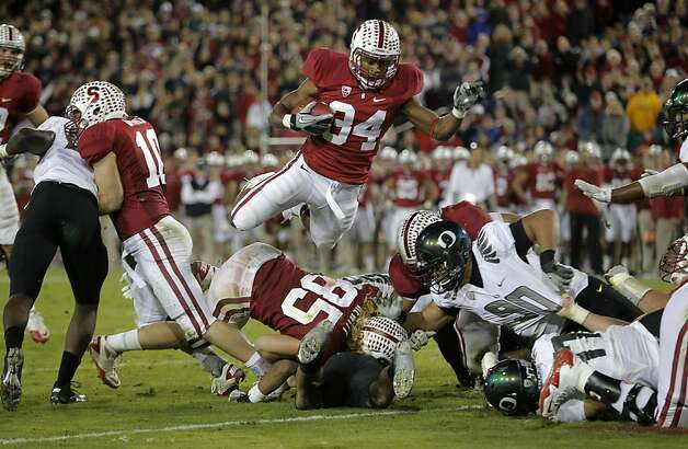 Stanford's Jeremy Stewart (34) jumps into the end zone on a 1-yard-run in the third quarter, as the Stanford Cardinal go on to lose to the  Oregon Ducks 53-30 at Stanford Stadium, on Saturday November 12, 2011 in Palo Alto, Ca. Photo: Michael Macor, The Chronicle