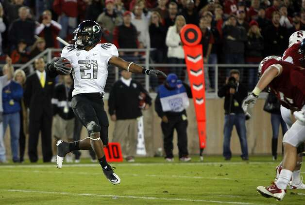 Oregon's LaMichael James(21) dances into the end zone for a third quarter touchdown, as the Stanford Cardinal go on to lose to the  Oregon Ducks 53-30 at Stanford Stadium, on Saturday November 12, 2011 in Palo Alto, Ca. Photo: Michael Macor, The Chronicle