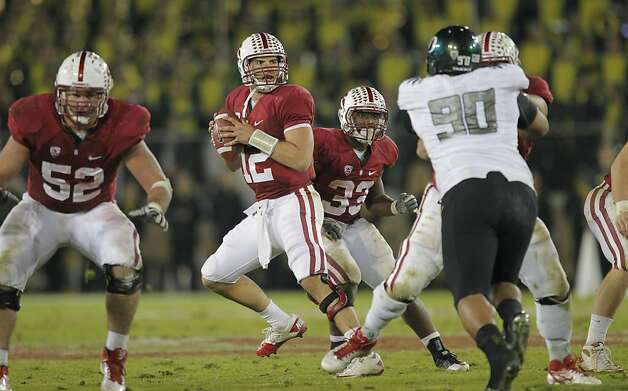 Stanford's Andrew Luck (12) looks to throw in the third quarter, as the Stanford Cardinal go on to lose to the  Oregon Ducks 53-30 at Stanford Stadium, on Saturday November 12, 2011 in Palo Alto, Ca. Photo: Michael Macor, The Chronicle
