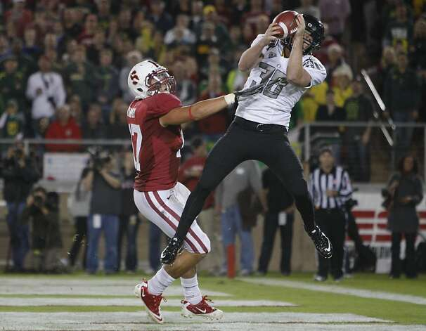 Oregon's Mike Garrity(38) hauls in a two point conversion pass in the first quarter over Stanford's A.J. Tarpley (17) on the coverage, as the Stanford Cardinal takes on the Oregon Ducks at Stanford Stadium, on Saturday November 12, 2011 in Palo Alto, Ca. Photo: Michael Macor, The Chronicle