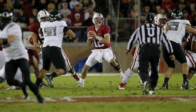Stanford's Andrew Luck (12) looks downfield in the second quarter, as the Stanford Cardinal takes on the Oregon Ducks at Stanford Stadium, on Saturday November 12, 2011 in Palo Alto, Ca. Photo: Michael Macor, The Chronicle