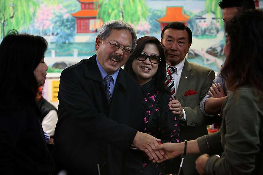 Mayor Ed Lee (middle) and his wife Anita Lee (middle,right)  greeting the lunch crowd at Lam Hoa Thuan during a merchant walk on Irving St. in San Francisco, Calif.,  on Thursday, November 10, 2011.  A lawyer in the district is Benny Yee (back, right). Photo: Liz Hafalia, The Chronicle