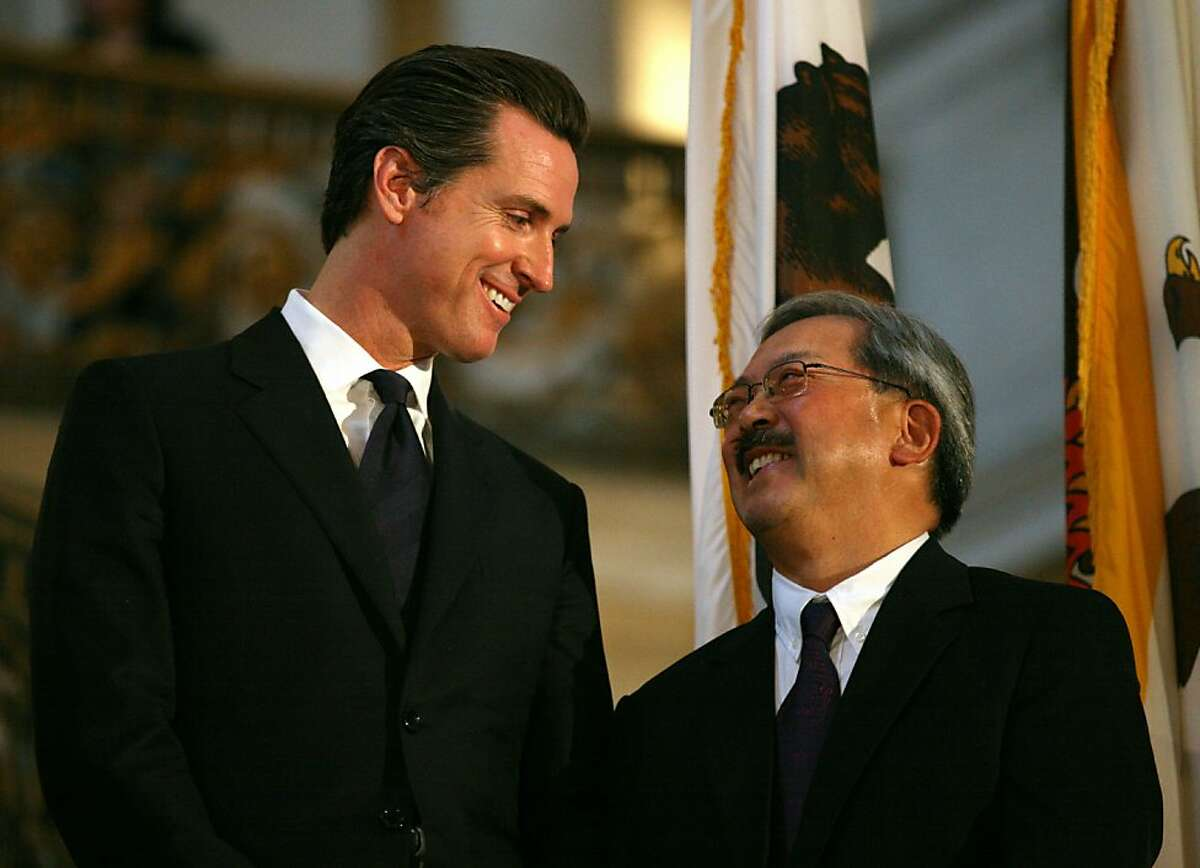 CORRECTION - NAME Former Mayor of San Francisco Gavin Newsom (R) shakes hands with the new San Francisco Mayor Edwin M Lee to celebrate the succession of the Mayor's office at the San Francisco City Hall on January 11, 2011 in California. Lee became the first Asian-American to take Mayor's office of San Francisco. AFP PHOTO / Kimihiro Hoshino (Photo credit should read KIMIHIRO HOSHINO/AFP/Getty Images) Ran on: 01-30-2011 Gavin Newsom (left) and Ed Lee: Height not the only difference.
