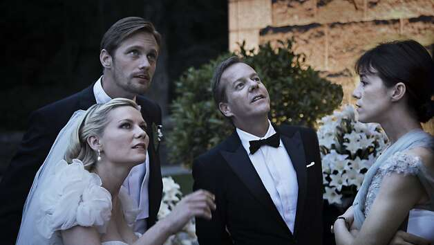 Kirsten Dunst, Alexander Skarsgaard, Kiefer Sutherland and Charlotte Gainsbourg in MELANCHOLIA, a Magnolia Pictures release.   Ran on: 11-11-2011 Photo: Christian Geisnaes, Magnolia Pictures