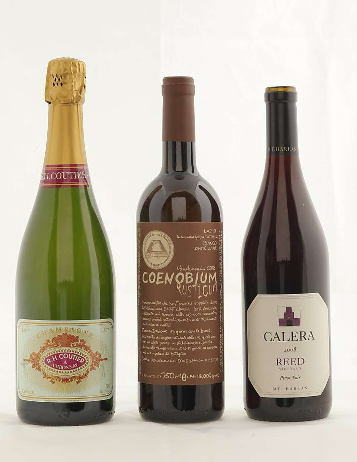 Left-right: NV R.H. Coutier Brut Tradition Grand Cru Champagne ($41, 12%, Beaune Imports) 2008 Monastere Suore Cisterncensi Coenobium Rusticum ($28, TK, Rosenthal Wine Merchant) 2008 Calera Reed Vineyard Mt. Harlan Pinot Noir ($50, 14.9%) as seen in San Francisco, California, on November 9, 2011.