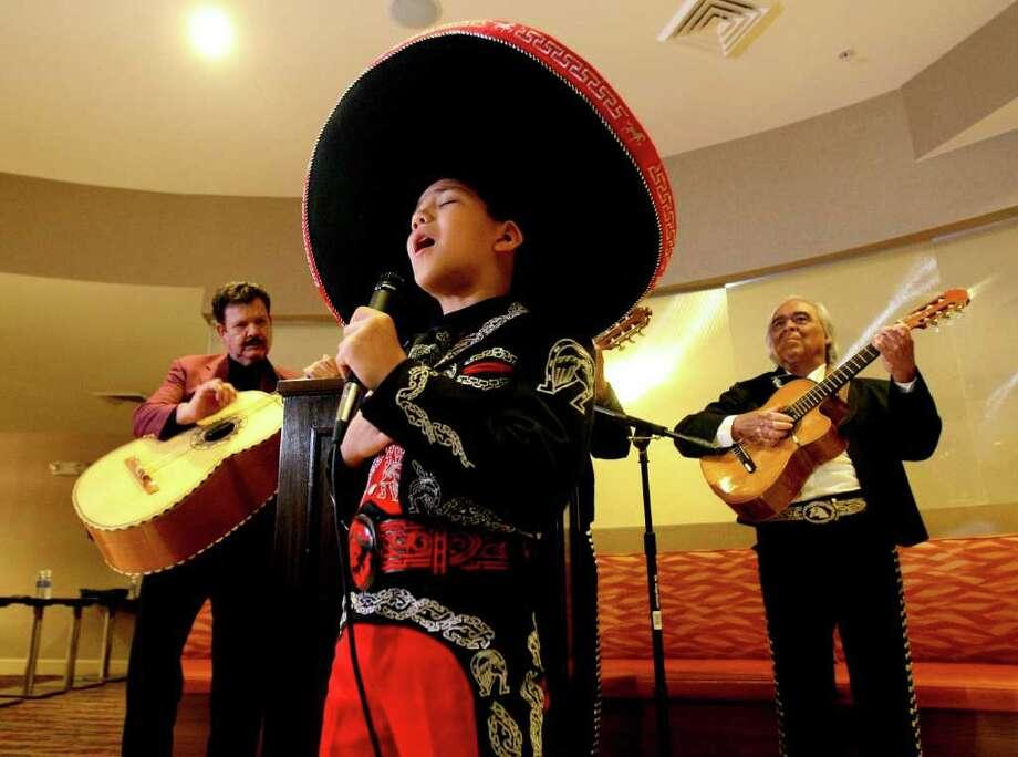 METRO: Sebastien De La Cruz, 9(Cq) , performs at a press conference on Monday Nov. 28, 2011 announcing the 17th Annual Mariachi Vargas Extravaganza.  HELEN L. MONTOYA/hmontoya@express-news.net Photo: HELEN L. MONTOYA, San Antonio Express-News / SAN ANTONIO EXPRESS-NEWS
