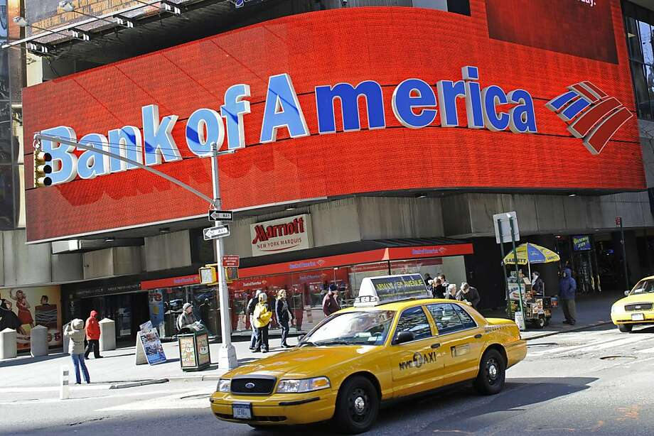 (FILES)Taxis drive past a Bank of America branch in New York in this February 23, 2009 file photo.  The US financial giant Bank of America is considering selling more of its shares in China's China Construction Bank (CCB) in order to shore up its capital, the Wall Street Journal reported on November 8, 2011. In August the struggling banking giant sold roughly half of its 10 percent share in the company for $8.3 billion dollars, strengthening its capital base and better implementing tougher standards imposed by global regulators. AFP PHOTO/Emmanuel Dunand (Photo credit should read EMMANUEL DUNAND/AFP/Getty Images) Photo: Emmanuel Dunand, AFP/Getty Images