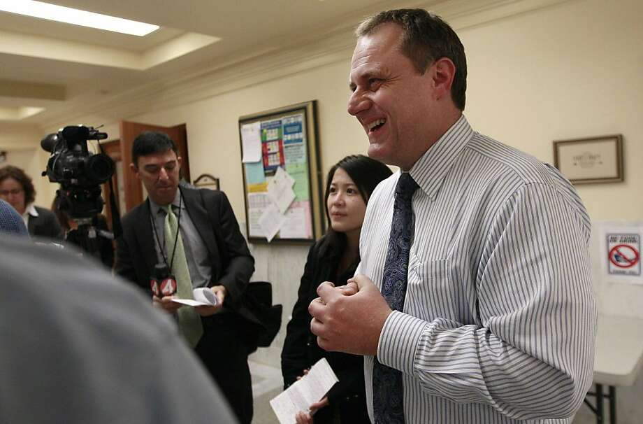 San Francisco Director of Elections John Arntz speaks to reporters outside of the Department of Elections at City Hall in San Francisco, Wednesday, Nov. 9, 2011. San Francisco voters are waiting to hear whether they had elected their first Asian-American as interim Mayor Ed Lee held a commanding lead against a diverse slate of 15 candidates. (AP Photo/Jeff Chiu)  Ran on: 11-13-2011 Elections Director John Arntz figures that when all is said and done, overall voter turnout will be only about 40 percent. Photo: Jeff Chiu, AP