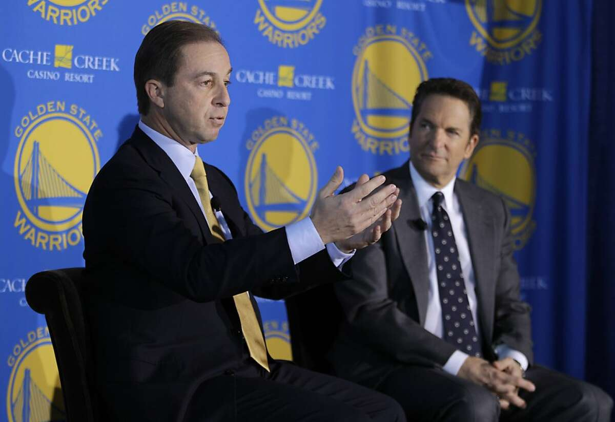 Golden State Warriors new owners Joe Lacob, left, gestures as Peter Guber, right, looks on during their introduction at a luncheon in San Francisco, Monday, Nov. 15, 2010. The sale of the Golden State Warriors NBA basketball team was completed last week to an ownership group headed by Lacob and Guber. Lacob will serve as co-executive chairman, CEO and governor and Guber will serve as co-executive chairman and alternate governor. (AP Photo/Eric Risberg) Ran on: 11-16-2010 Joe Lacob (left) will be involved with basketball and business, and Peter Guber (right) will deal with the fan experience.