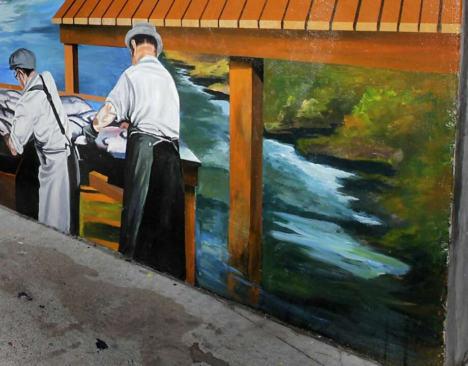 Mural artist Mario Alfaro painted over a scene showing a beaver (lower right) after Martinez city officials were unhappy with the image depicting the Alhambra Creek residents. Photo: Paul Chinn, The Chronicle