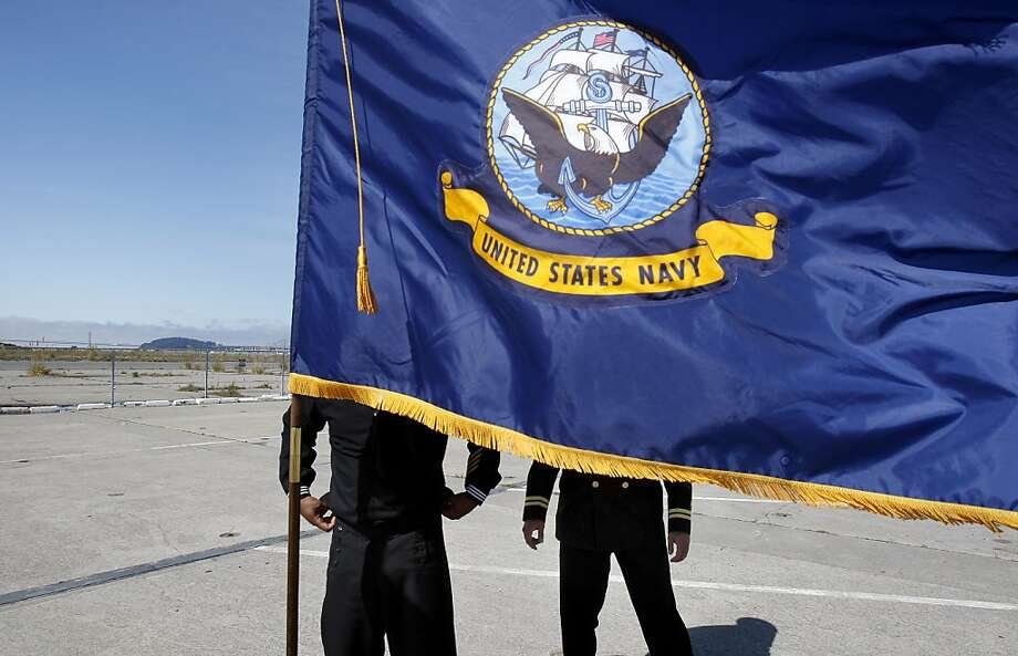 Members of the Navy arranged flags for the ceremony. Alameda Point is in background. The City of Alameda and the Department of the Navy have come to an agreement for the city to take over 918 acres of the former Naval Air Station now called Alameda Point. Photo: Brant Ward, The Chronicle