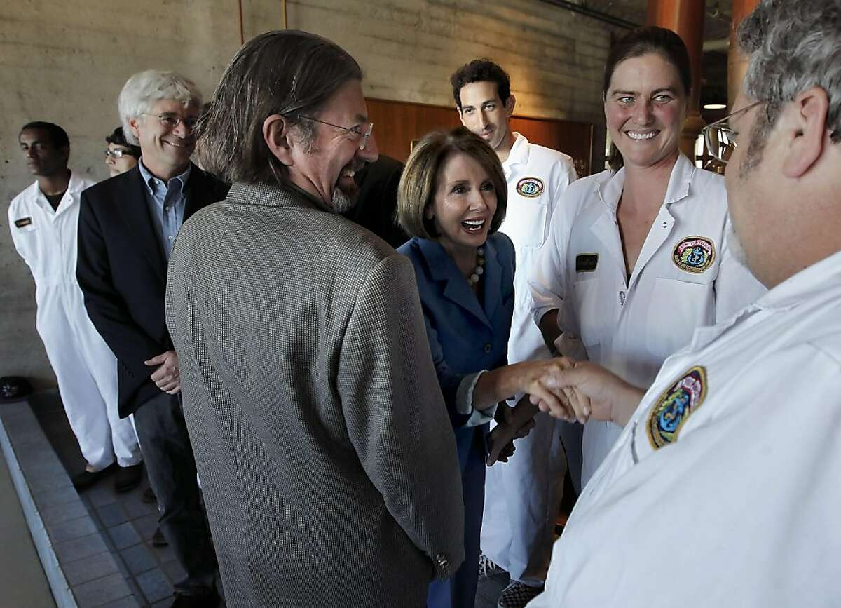 Democratic Leader Nancy Pelosi greets a few of the brewers before holding a roundtable with local manufacturers, at the Anchor Steam Brewing Co., in San Francisco, Ca., on Thursday September 29, 2011. The brewery owner Keith Greggor is to her right. The meeting was called to discuss House Democrats'
