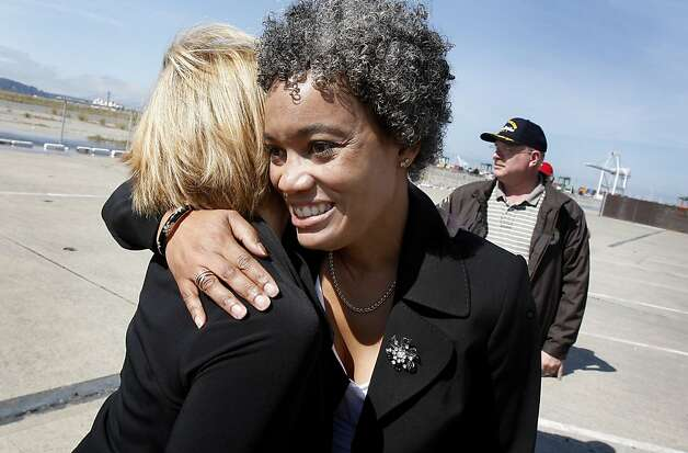 Alameda Mayor Marie Gilmore gets a hug from a friend after announcing the deal with the Navy. The City of Alameda and the Department of the Navy have come to an agreement for the city to take over 918 acres of the former Naval Air Station now called Alameda Point. Photo: Brant Ward, The Chronicle