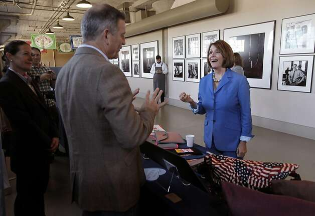 "Democratic Leader Nancy Pelosi speaks with small business owner Mark Dwight of Rickshaw Bags, before sitting down for a roundtable with local manufacturers, at the Anchor Steam Brewing Co., in San Francisco, Ca., on Thursday September 29, 2011, to discuss the House Democrats' ""Make It In America"" initiative, President Obama's American Jobs Act, and how Congress can best help small businesses grow and hire. Photo: Michael Macor, The Chronicle"
