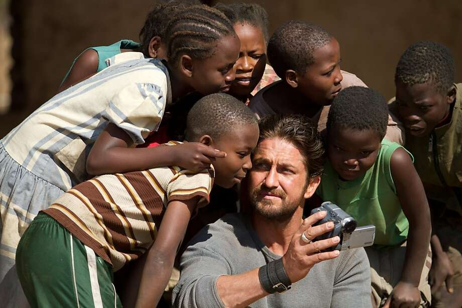 "M 20  Gerard Butler, ""Sam Childers"", the impassioned founder of Angels of East Africa rescue organization, brings hope where there is none to hundreds of children in Relativity Media's release MACHINE GUN PREACHER. Photo: Ilze Kitshoff, Relativity Media"