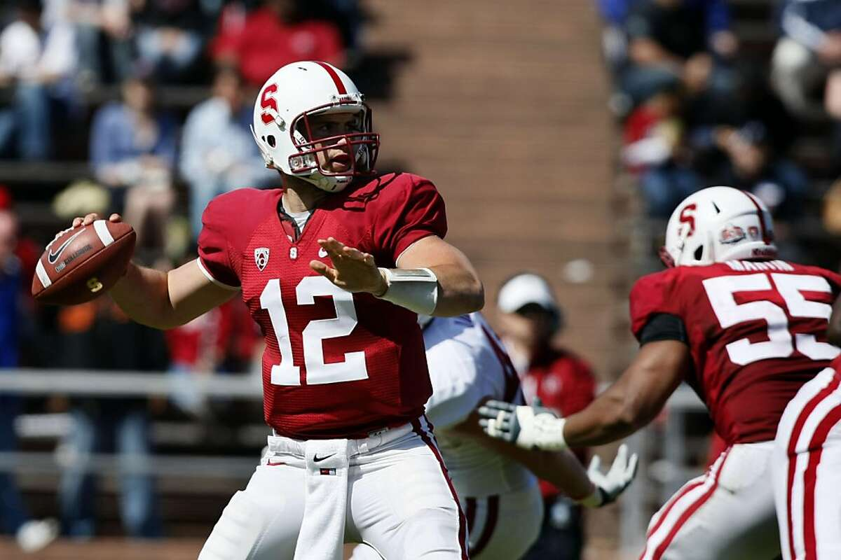 Stanford's superstar QB Andrew Luck steps into the pocket and fires a touchdown pass in the third quarter of their annual spring scrimmage game. This year's event took place at Kezar Stadium in San Francisco CA Saturday, April 9, 2011.