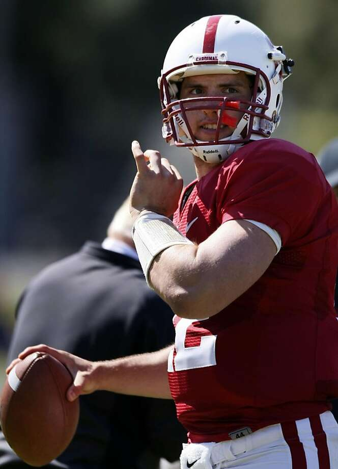 Stanford's superstar QB Andrew Luck warms up on the sidelines prior to the start of Stanford football annual spring scrimmage game. This years event took place at Kezar Stadium in San Francisco CA Saturday, April 9, 2011.    Ran on: 04-10-2011 Stanford quarterback Andrew Luck gets loose. He threw three TD passes at Kezar Stadium. B7 Ran on: 04-10-2011 Andrew Luck threw for three TDs in the spring game  --  and the defense couldn't hit him. B7  Ran on: 07-21-2011 Andrew Luck returned so he could earn a Stanford degree. Ran on: 07-21-2011 Andrew Luck returned so he could earn a Stanford degree. Photo: Lance Iversen, The Chronicle