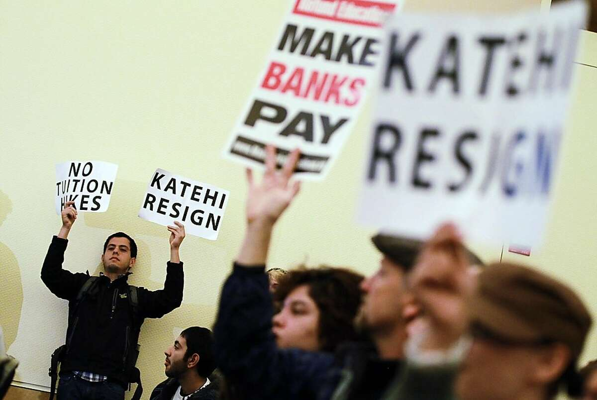 DAVIS, CA - NOVEMBER 28: Protestors hold signs asking UC Davis chancellor Linda Katehi to resign during a UC Regents meeting on the UC Davis campus on November 28, 2011 in Davis, California. Student protesters and members of the Occupy movement are calling for a general strike at the UC Davis campus to coincide with the UC Regents meeting that is being held on four UC campuses. Students are outraged in the wake of an incident where a UC Davis police officer pepper sprayed protestors who sat passively with their arms locked. (Photo by Justin Sullivan/Getty Images)