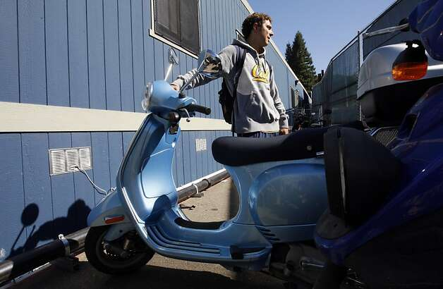 Cal's kicker #40 Giorgio Tavecchio leaves the weight room at the university training center on his personal vespa scooter. The University of California at Berkeley may have the largest contingent of scooters in the Bay-area. Almost everyone on the cal football team, along with other athletes uses them to get around campus that has a serious parking problem Tuesday, Sept. 27, 2011. Photo: Lance Iversen, The Chronicle