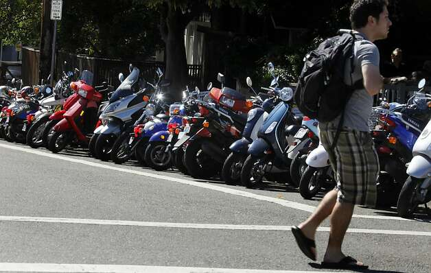 Hundreds of scooter are parked across from campus Tuesday, Sept. 27, 2011. The University of California at Berkeley may have the largest contingent of scooters than anyone else in the Bay-area. Almost everyone on the cal football team, along with other athletes uses them to get around a campus that has a serious parking problem. Photo: Lance Iversen, The Chronicle