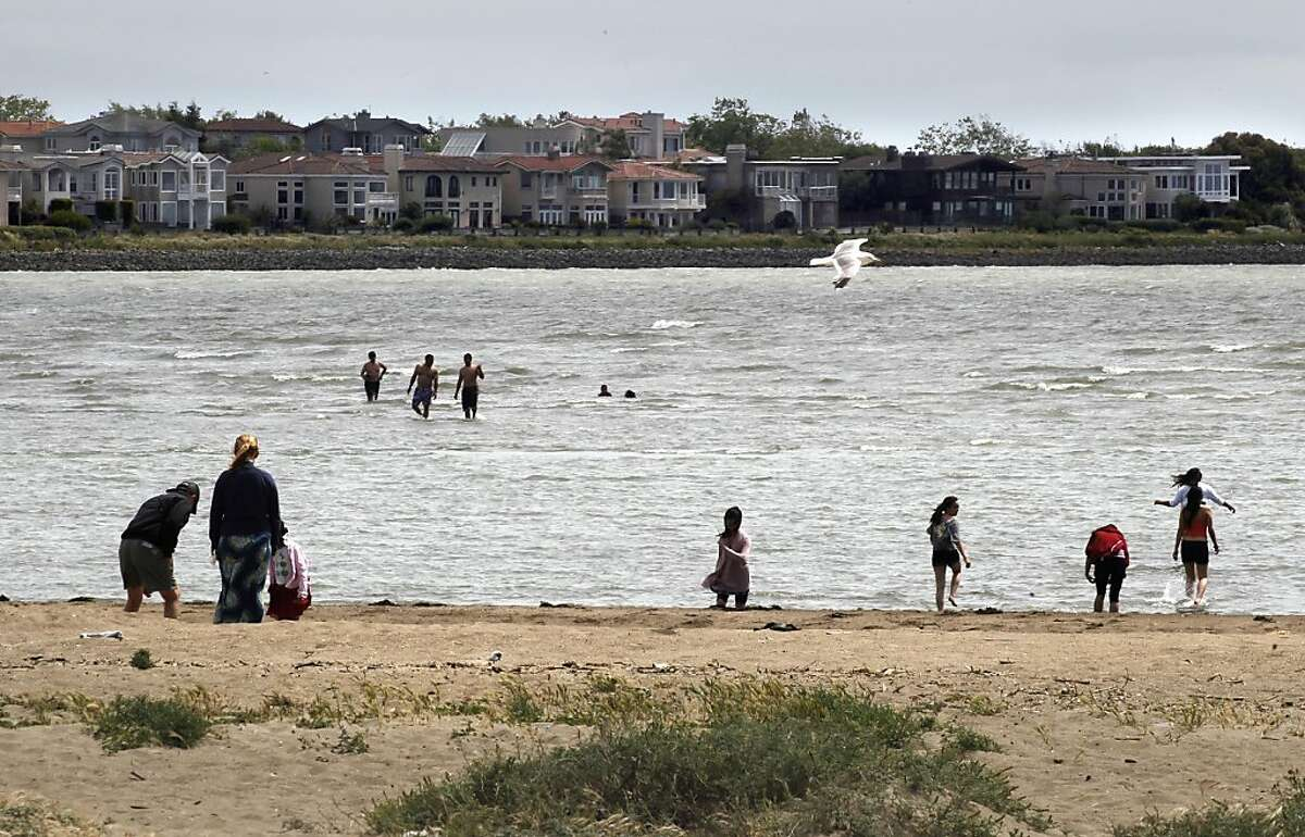 Swimmers can be seen out in the shallow waters off of Crown Beach on Saturday June 11, 2011, in Alameda, Ca. Many Alameda residents are voicing concerns over the way the Fire Department and other City officials handled the drowning of Raymond Zack, last week along Crown Memorial State Beach. City officials say rescue personnel were unable to enter the water, due to no water rescue training. Ran on: 06-13-2011 Robert Zack died in these waters off Crown Beach in plain view of police officers and firefighters. Ran on: 06-13-2011 Robert Zack died in these waters off Crown Beach in plain view of police officers and firefighters.