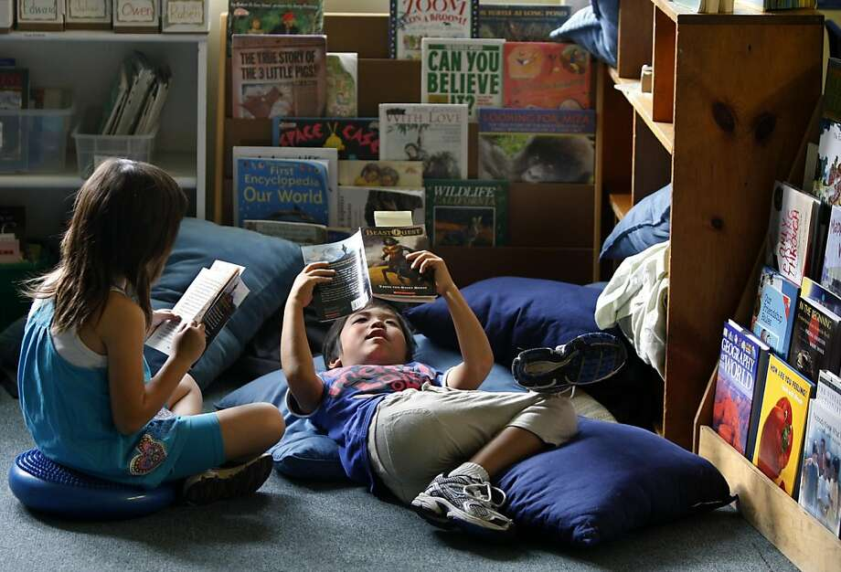 Erika Cao (left) and Kaito Takenaka read books in their 3rd grade class at Windrush School in El Cerrito, Calif. on Thursday, Sept. 29, 2011. Founded 35 years ago on the historic site of the old Chung Mei Home for Boys, the private K-8 school faces closure at the end of the school year if it can't come up with $800,000 to pay the bills. Photo: Paul Chinn, The Chronicle