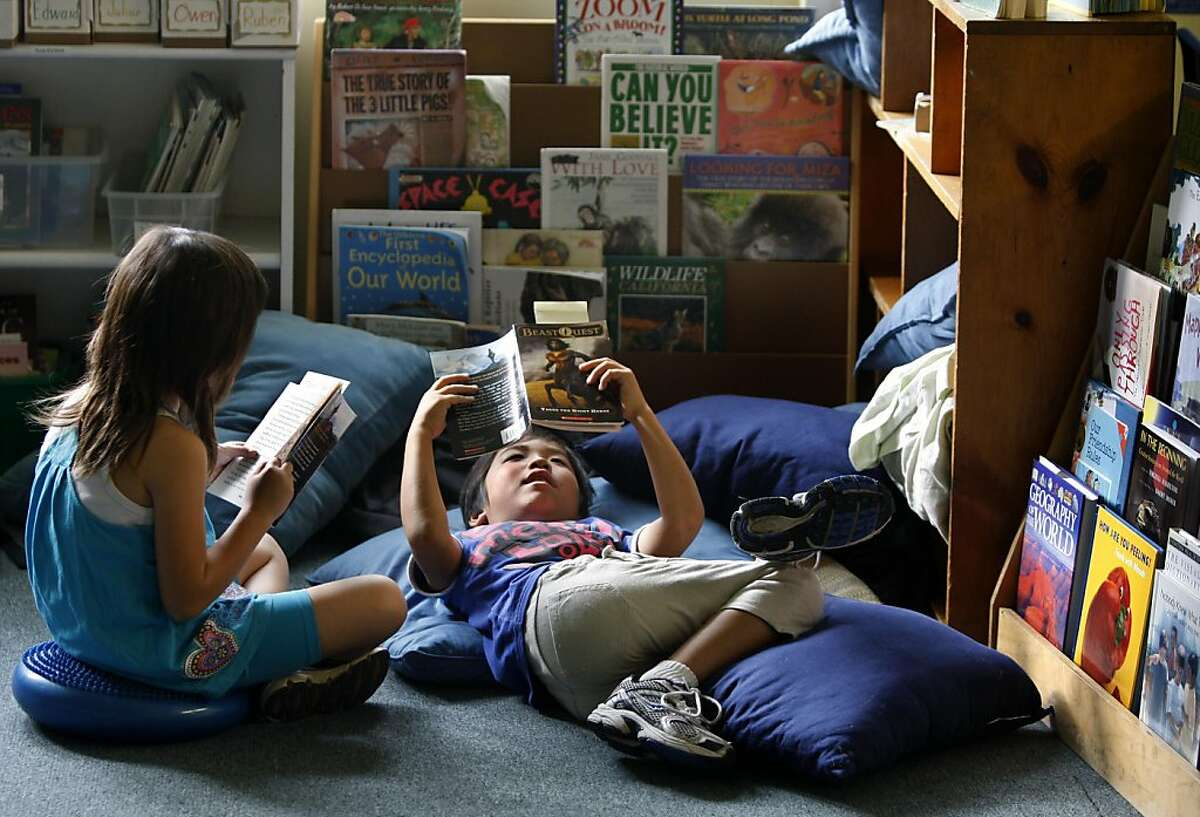 Erika Cao (left) and Kaito Takenaka read books in their 3rd grade class at Windrush School in El Cerrito, Calif. on Thursday, Sept. 29, 2011. Founded 35 years ago on the historic site of the old Chung Mei Home for Boys, the private K-8 school faces closure at the end of the school year if it can't come up with $800,000 to pay the bills.