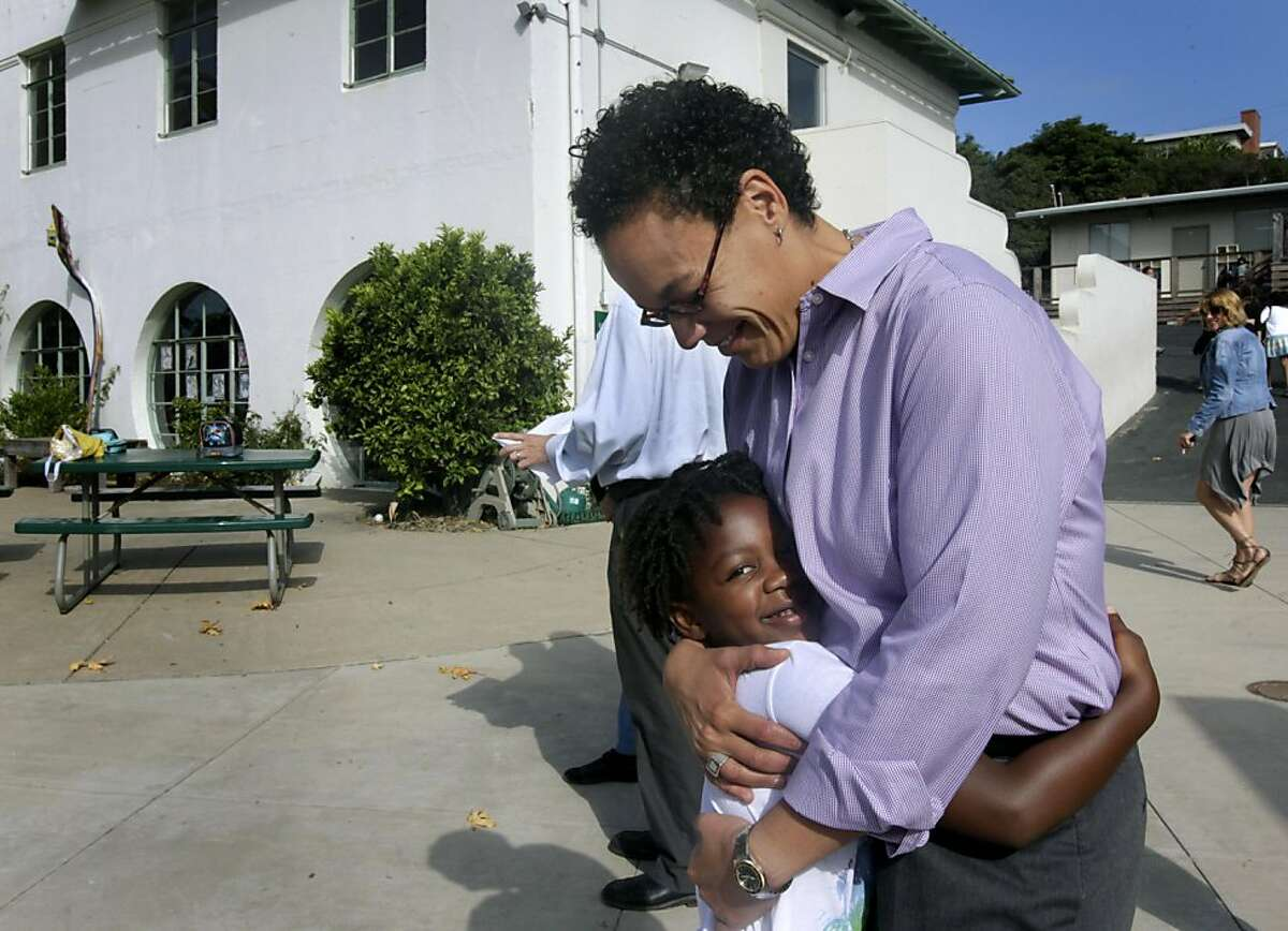 First grader Sharmari Gordon hugs Head of School Ilana Kaufman at Windrush School in El Cerrito, Calif. on Thursday, Sept. 29, 2011. Founded 35 years ago on the historic site of the old Chung Mei Home for Boys, the private K-8 school faces closure at the end of the school year if it can't come up with $800,000 to pay the bills.
