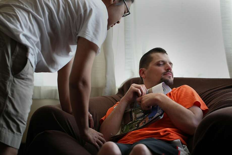 "Jason Napoliello, 31, a developmentally disable man living in his own apartment,  with his caregiver, Zayar Ohn (lft) work on life skills together at home on Wednesday Sept. 28, 2011 in San Francisco Calif.  Ohn says Napoliello needs round the clock care and can not be alone even a minute without fear that he will hurt himself. Ohn is employed by The Supported Living Services of The Arc San Francisco,a facility that helps facility this kind of care for developmentally disable people, and because a of state budget cuts is faced with a $300k deficit in this department alone.  ""I can always find a job at a coffee shop but for Jason is wold be really hard if I were not hear,"" said Ohn   Ran on: 09-29-2011 Joseph Napoliello, who has a severe developmental disability, works on life skills with his caregiver, Zayar Ohn. Ran on: 09-29-2011 Joseph Napoliello, who has a severe developmental disability, works on life skills with his caregiver, Zayar Ohn. Ran on: 09-29-2011 Joseph Napoliello, who has a severe developmental disability, works on life skills with his caregiver, Zayar Ohn. Photo: Mike Kepka, The Chronicle"