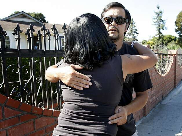 Mario Avieles gets a hug from Dorothy McGee as the two meet near the spot where the young schoolgirl was run over.  Avieles knew the girl, his own children are in her class. Two fatalities were reported in East Palo Alto Wednesday September 28, 2011.  The first when an SUV being chased by police ran into a motorcyclist killing him, the second when a young schoolgirl was run over in a crosswalk only a few blocks away. Photo: Brant Ward, The Chronicle