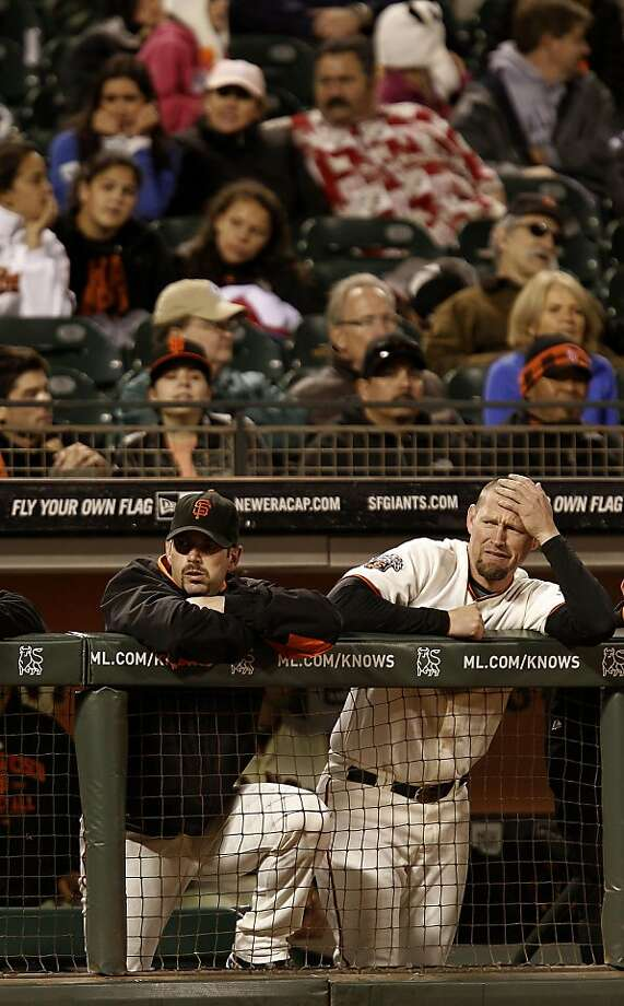 Giants Aaron Rowand and aubrey Huff watch in the ninth inning as the San Francisco Giants fall to the Chicago Cubs 5-2, at AT&T Park,  in San Francisco, Ca., on Tuesday August 30, 2011. Photo: Michael Macor, The Chronicle