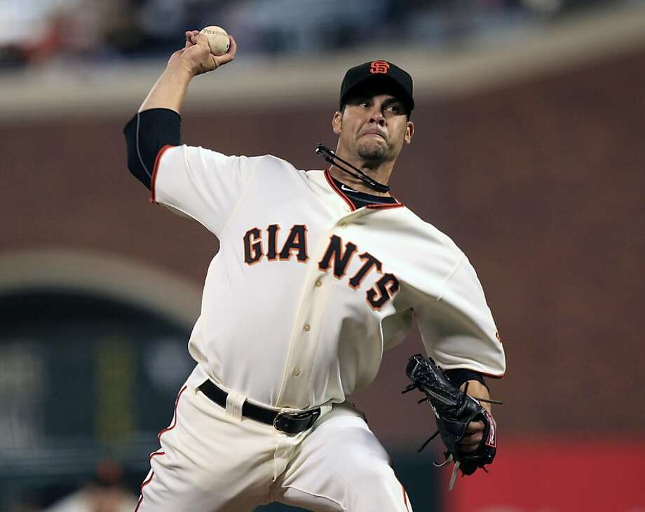 San Francisco Giants starting pitcher Ryan Vogelsong throws to the Colorado Rockies during the first inning of a baseball game in San Francisco,  Monday, Sept. 26, 2011. (AP Photo/Marcio Jose Sanchez) Photo: Marcio Jose Sanchez, AP