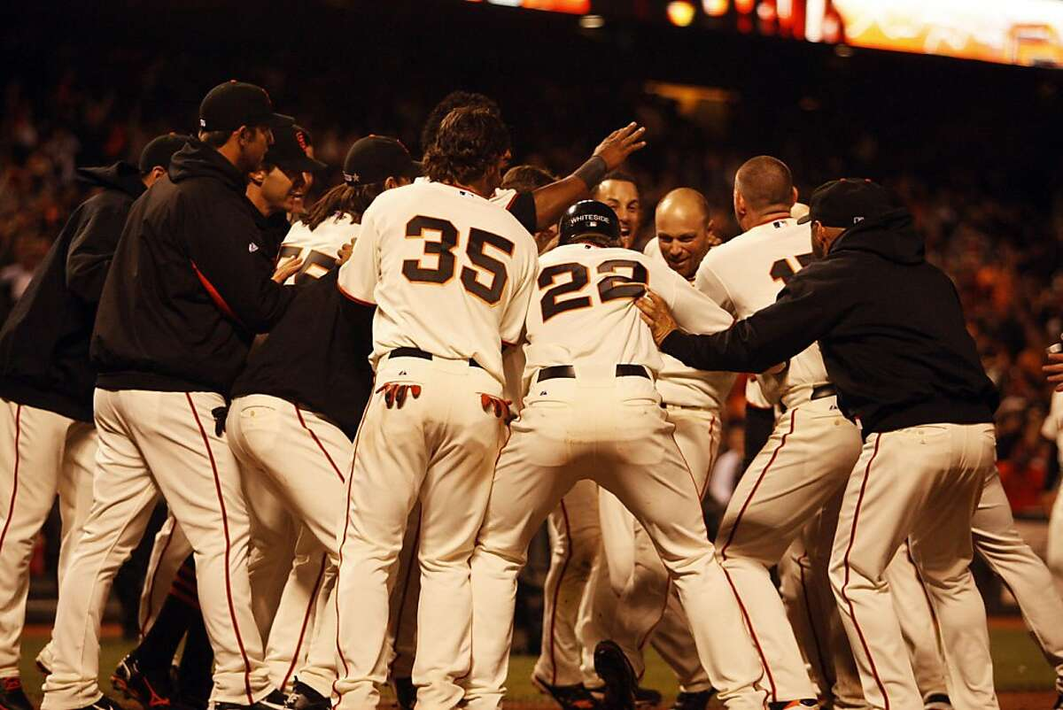 The Giants celebrate after Nate Schierholtz scores the winning home run during the 14th inning at the San Francisco Giants versus the San Diego Padres games held at AT&T Park on Wednesday, July 6, 2011. The Giants won 6-5 in 14 innings.