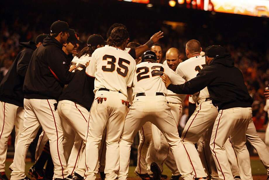 The Giants celebrate after Nate Schierholtz scores the winning home run during the 14th inning at the San Francisco Giants versus the San Diego Padres games held at AT&T Park on Wednesday, July 6, 2011. The Giants won 6-5 in 14 innings. Photo: Maddie McGarvey, The Chronicle