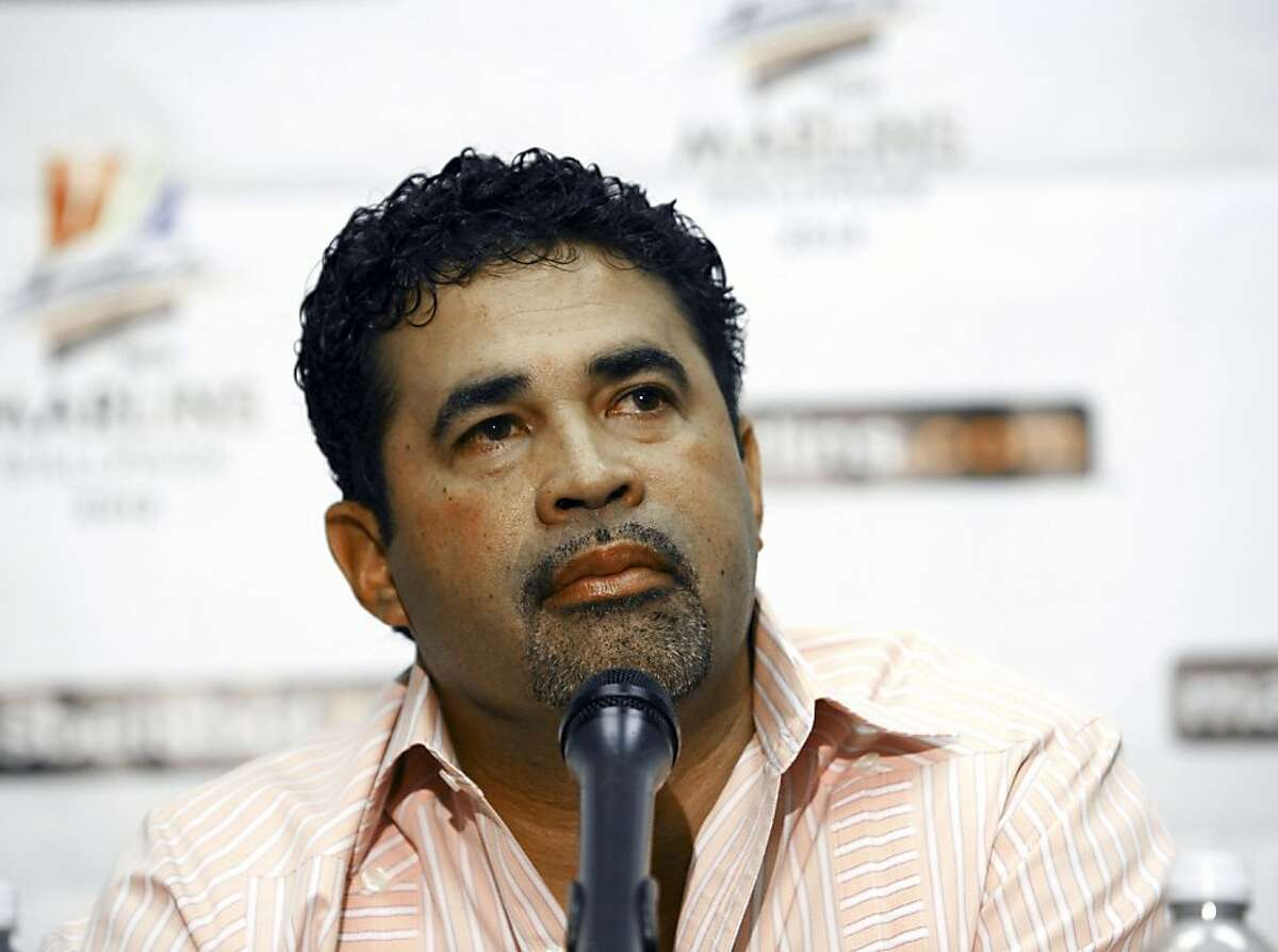 """Ozzie Guillen, the former Chicago White Sox manager, talks to the media during a press conference in Miami, Wednesday, Spet. 28, 2011. Hours before the final game in the stadium they're leaving, the Marlins formally introduced Guillen as their manager for 2012. """"We're very excited,"""" Guillen said at a stadium news conference Wednesday. """"It's a big, big step in my career, a new chapter. Hopefully I can bring energy, flavor and enthusiasm, but the most important thing is a winning team."""" (AP Photo/J Pat Carter)"""