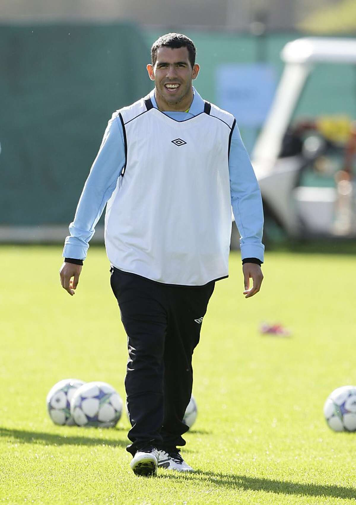 Manchester City's Carlos Tevez trains with teammates at Carrington training ground, Manchester, England, Monday Sept. 26, 2011. Manchester City will play Bayern Munich in Germany on Tuesday in a Champions League Group A soccer match. (AP Photo/Jon Super)