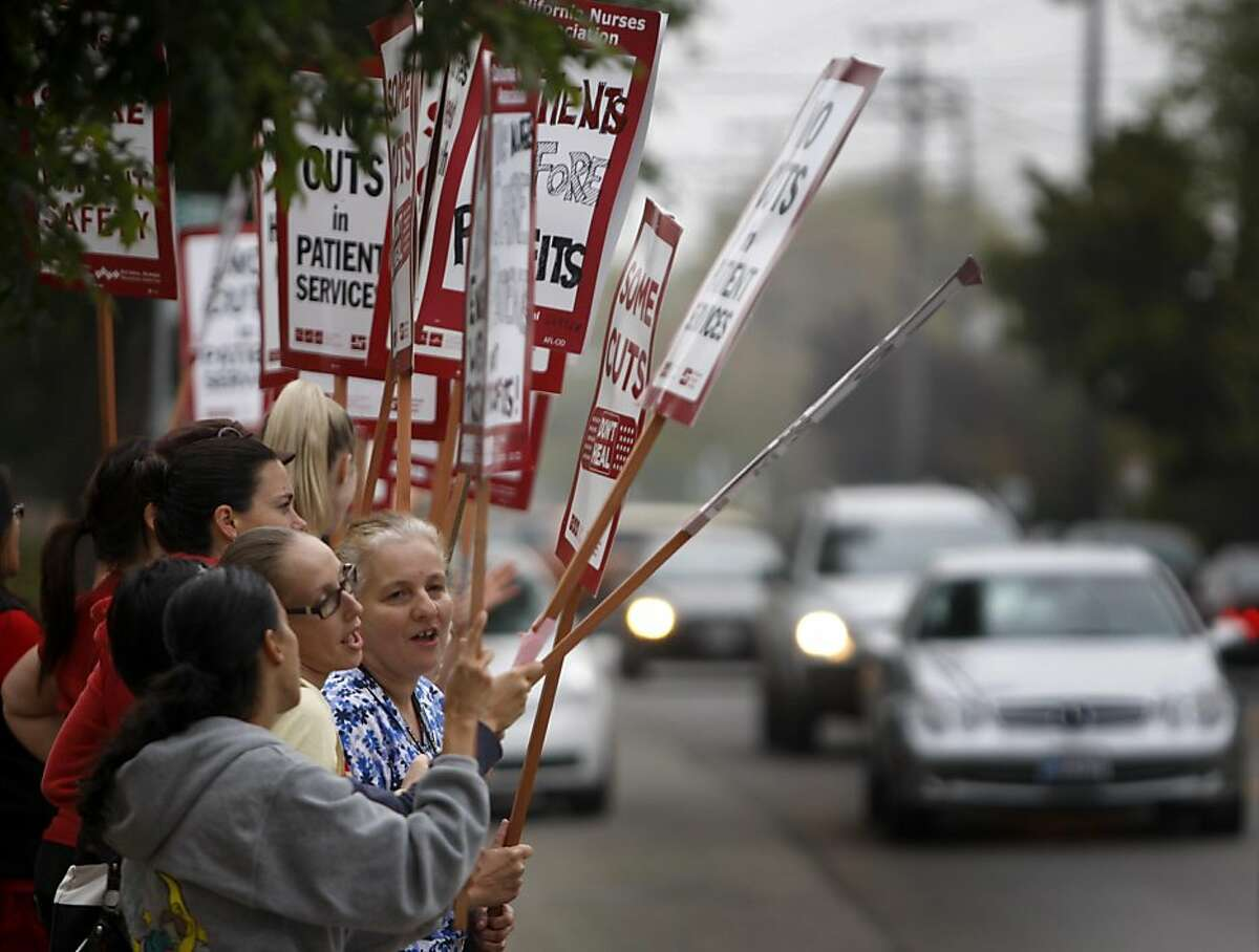 Nurses chant union slogans while staging a one-day strike at Alta Bates Summit Medical Center in Berkeley, Calif. on Thursday, Sept. 22, 2011, to protest concessions in their contract proposed by hospital management.