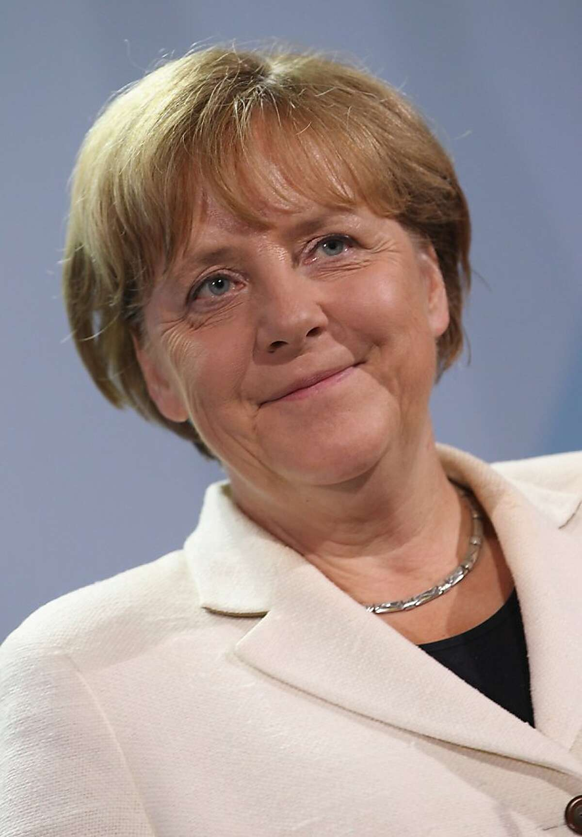 BERLIN, GERMANY - SEPTEMBER 27: German Chancellor Angela Merkel speaks to the media prior to talks with Greek Prime Minister George Papandreou at the Chancellery on September 27, 2011 in Berlin, Germany. The two leaders are meeting to discuss the current Greek debt crisis that is threatening the stability of the Euro two days before the Bundestag is scheduled to vote on an increase in funding for the European Financial Stability Facility (EFSF). (Photo by Sean Gallup/Getty Images)