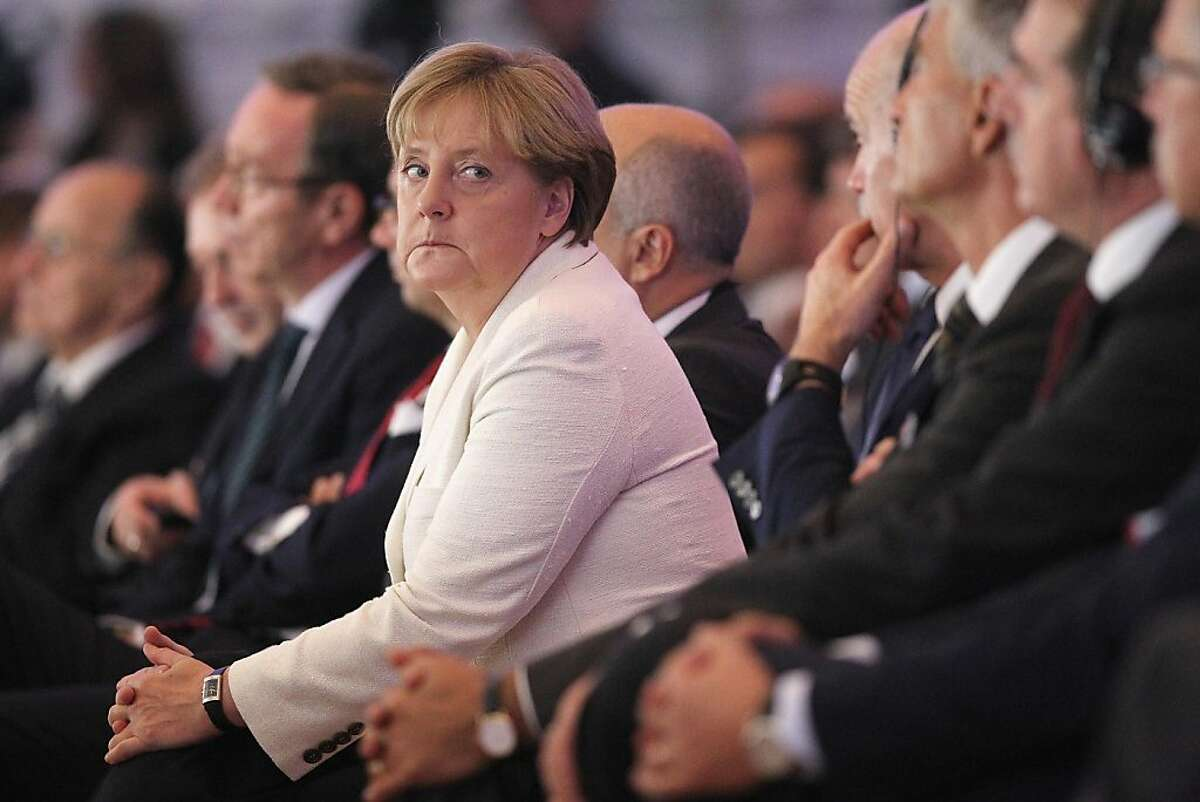 BERLIN, GERMANY - SEPTEMBER 27: German Chancellor Angela Merkel and Greek Prime Minister George Papandreou (4th from R) attend a convention of the Federation of German Industry (BDI), where Papandreou spoke in an appeal for more German investment in Greece, on September 27, 2011 in Berlin, Germany. Papandreou and Merkel are scheduled to meet at the Chancellery later in the day to discuss the current Greek debt crisis that is threatening the stability of the Euro. (Photo by Sean Gallup/Getty Images) *** BESTPIX ***