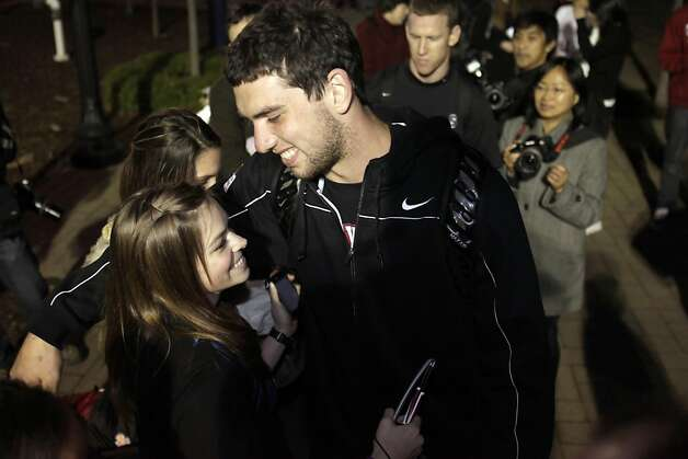 Andrew Luck hugs friend, Shelley Alexander after the Stanford football team returned to Stanford University on Tuesday, January 4, 2011, after their victory in the Orange Bowl against Virginia Tech the previous night. The team was greeted by several hundred supporters and fellow students. Photo: Carlos Avila Gonzalez, The Chronicle