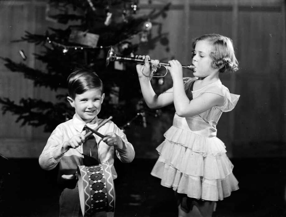 December 1936:  Children play with the musical instruments they received from Santa for Christmas.  (Photo by Fox Photos/Getty Images) Photo: Fox Photos / Hulton Archive