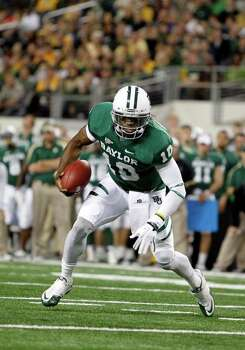 Baylor quarterback Robert Griffin III (10) during an NCAA college football game against Texas Tech on Saturday, Nov. 26, 2011, in Arlington, Texas. Photo: AP