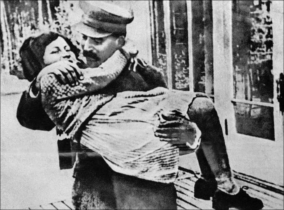 Joseph Stalin, Premier of the Sovier Union from 1941-1953, holds his daughter Svetlana Stalina (Lana Peters). Photo: AFP/Getty Images / AFP