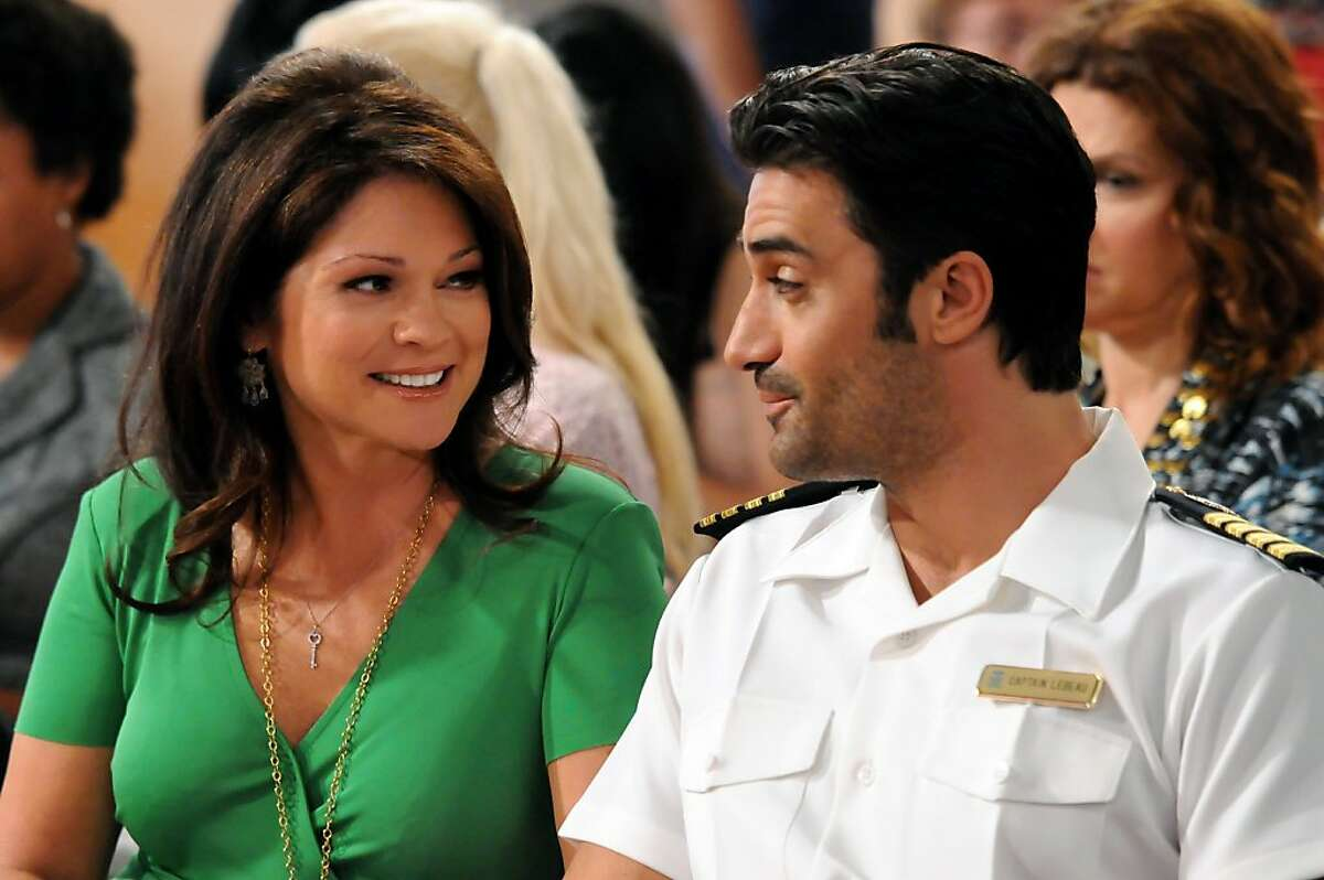 (Left to right: Valerie Bertinelli and guest star Gilles Marini) Captain LeBeau (Marini) takes a moment to connect with the passengers of his all-female gay cruise, taking a seat with the very straight Ð and very eager Ð Melanie (Bertinelli). ?'Hot in Cleveland?