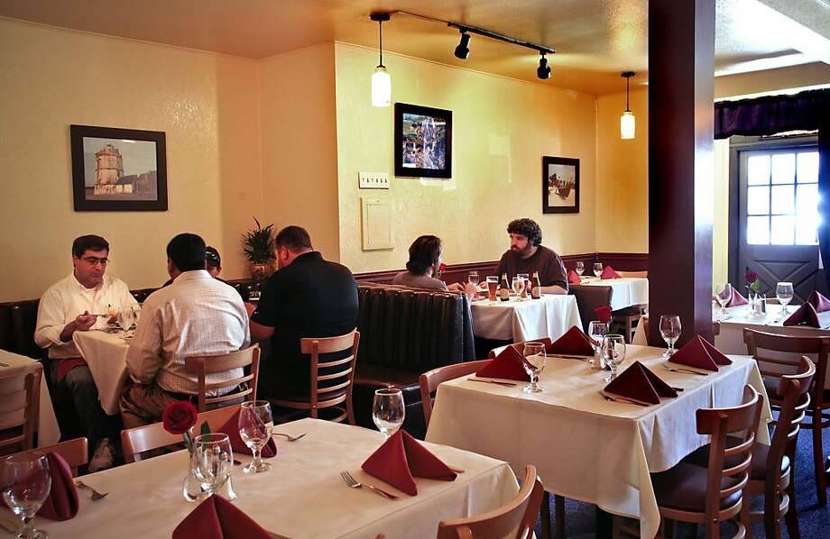 Diners enjoy lunch at Viva Goa Restaurant In San Francisco, Calif.,  on June 30th, 2011. Photo: John Storey, Special To The Chronicle