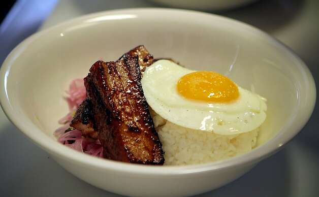 The 24hr Pork Belly with a fried egg at Hawker Fare restaurant in Oakland, Calif., is seen on July11th, 2011. Photo: John Storey, Special To The Chronicle