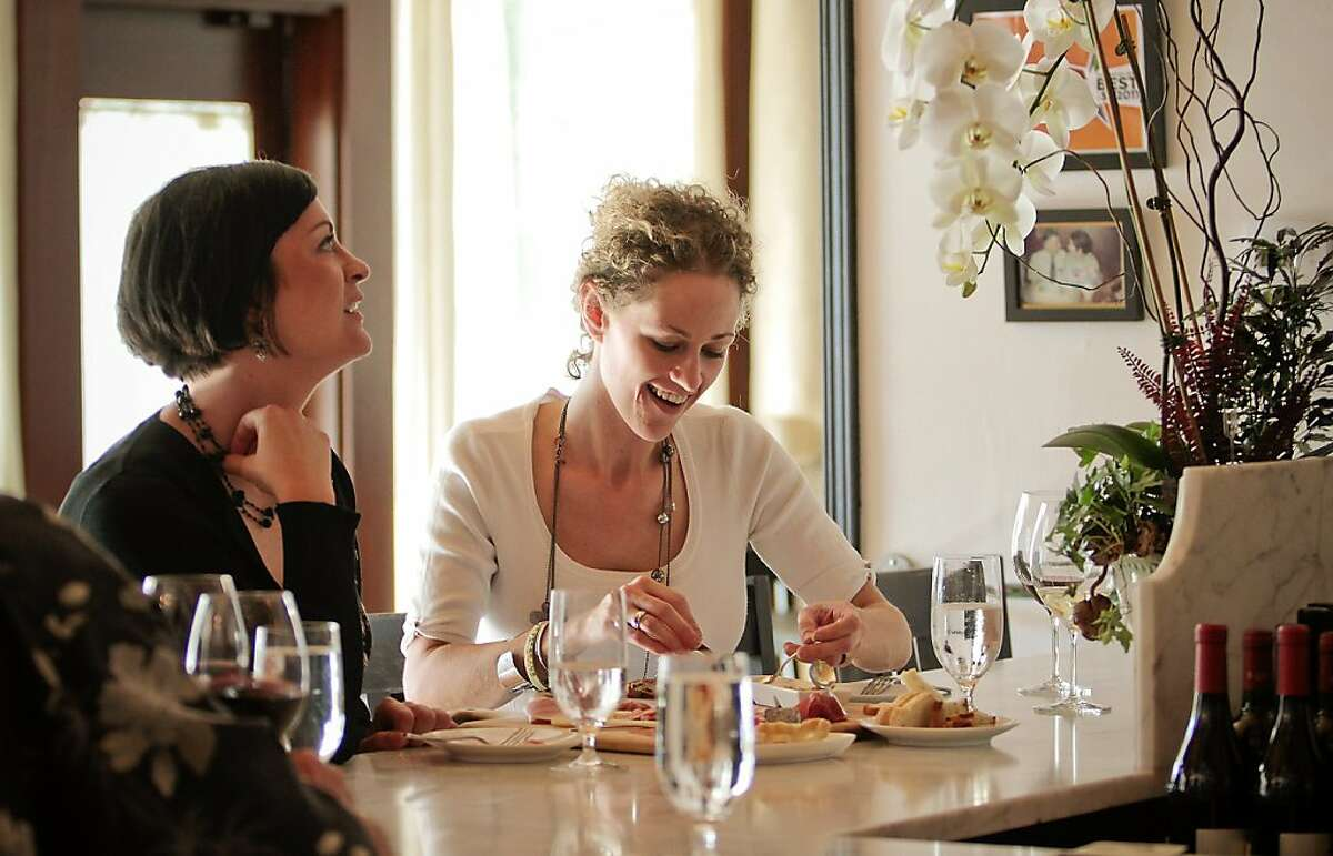 Two women enjoy some wine and crostini at Enoteca La Storia in Los Gatos, Calif., on July 6th, 2011.